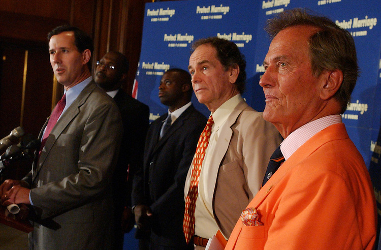 Sen. Rick Santorum, R-Pa., left, appears at a news conference with celebrities who spoke out in support of the amendment that would ban same sex marriage.  From left are Santorum, Marvin Winans, godpel singer, Darrell Green, former Redskin, Dean Jones, actor, and singer Pat Boone.