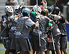 Long Island Outlaws teammates celebrate their 10-9 overtime win over Rock Lax in a Warrior Lacrosse Classic Varsity A tournament game at Hofstra University on Sunday, July 17, 2016.