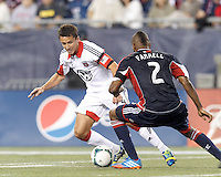 D.C. United substitute midfielder Lewis Neal (24) dribbles on offense. In a Major League Soccer (MLS) match, the New England Revolution (blue) defeated D.C. United (white), 2-1, at Gillette Stadium on September 21, 2013.