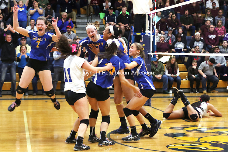 EAST HAVEN CT. 19 November 2016-111916SV03-Seymour High players celebrate after beating Torrington High 3-0 in the CIAC Class M Volleyball championship game at East Haven High in East Haven Saturday.<br /> Steven Valenti Republican-American