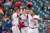 Kennon Fontenot (14) of the Louisiana Ragin' Cajuns celebrates with teammates O'Neal Lochridge (7) and Hunter Kasuls (19) after hitting a home run against the Vanderbilt Commodores in game five of the 2018 Shriners Hospitals for Children College Classic at Minute Maid Park on March 3, 2018 in Houston, Texas.  The Rajin' Cajuns defeated the Commodores 3-0.  (Brian Westerholt/Four Seam Images)