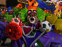 A member of Sao Clemente samba school performs during parade at the Sambadrome, Rio de Janeiro, Brazil, March 2, 2014.  (Austral Foto/Renzo Gostoli)