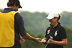 Angela Buzminski slaps hands with her caddie after making her putt on the 17th hole at Alliance Bank Golf Classic in Syrcause, NY.