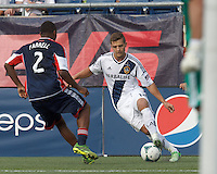 LA Galaxy substitute midfielder Robbie Rogers (14) controls the ball. In a Major League Soccer (MLS) match, the New England Revolution (blue) defeated LA Galaxy (white), 5-0, at Gillette Stadium on June 2, 2013.