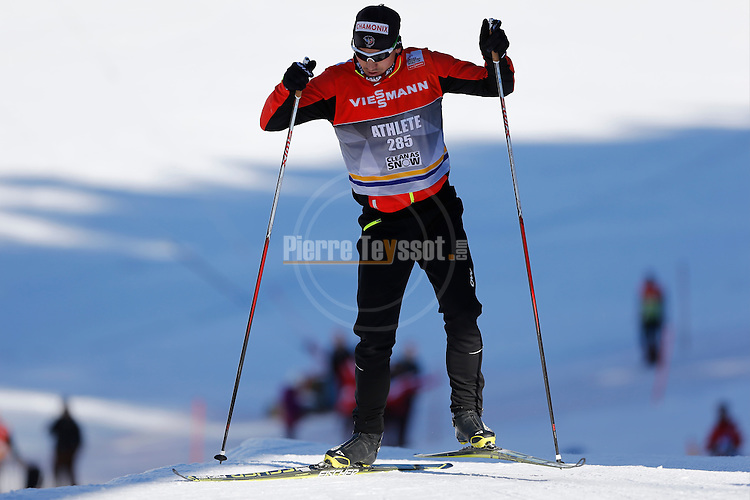 Skier competes the Men 15 km individual free event as part of the Nordic skiing FIS Cross-country World Cup, in Davos on December 20, 2014.