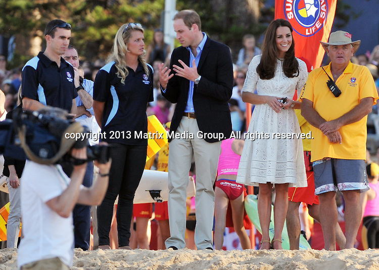 18 APRIL 2014 SYDNEY AUSTRALIA<br /> <br /> NON EXCLUSIVE <br /> <br /> HRH The Duke &amp; Duchess of Cambridge pictured at Manly Beach inspecting and meeting with the Manly Surf Life Savers. Kate was in great spirits as she made a dash in her heels across the sand to fire the starting gun for a surf paddle race. <br /> <br /> *No web/digital use without clearance*<br /> MUST CALL PRIOR TO USE .<br /> +61 2 9211-1088<br /> Matrix Media Group<br /> Note: All editorial images subject to the following: For editorial use only. Additional clearance required for commercial, wireless, internet or promotional use.Images may not be altered or modified. Matrix Media Group makes no representations or warranties regarding names, trademarks or logos appearing in the images.