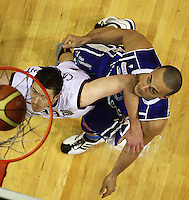 Saints forward Brendon Polybank watches his shot beat Heat forward Daryl Cartwright during the National Basketball League match Wellington Saints and Harbour Heat at TSB Bank Arena, Wellington, New Zealand on Saturday 13 June 2009. Photo: Dave Lintott / lintottphoto.co.nz