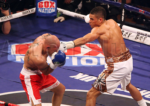 27.04.2013 Sheffield, England. Anthony Ogogo (white shorts) against Keiron Gray (red shorts) from the Motorpoint Arena .