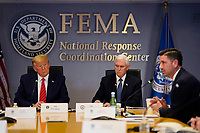 United States President Donald J. Trump, left, and US Vice President Mike Pence listen as acting Secretary of Homeland Security Chad Wolfspeaks during a teleconference with governors at the Federal Emergency Management Agency headquarters, Thursday, March 19, 2020, in Washington, DC.<br /> Credit: Evan Vucci / Pool via CNP/AdMedia