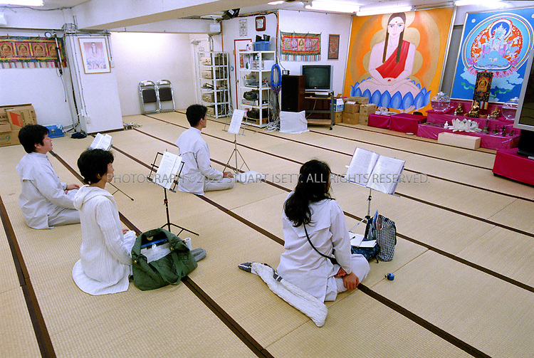 7/8/2002--Tokyo, Japan..Members of Aleph meditate at the groups headquarters in Tokyo. Aleph was formerly know as AUM, the cult accused of the 1995 nerve gas attacks on the Tokyo subway...All photographs ©2003 Stuart Isett.All rights reserved.This image may not be reproduced without expressed written permission from Stuart Isett.