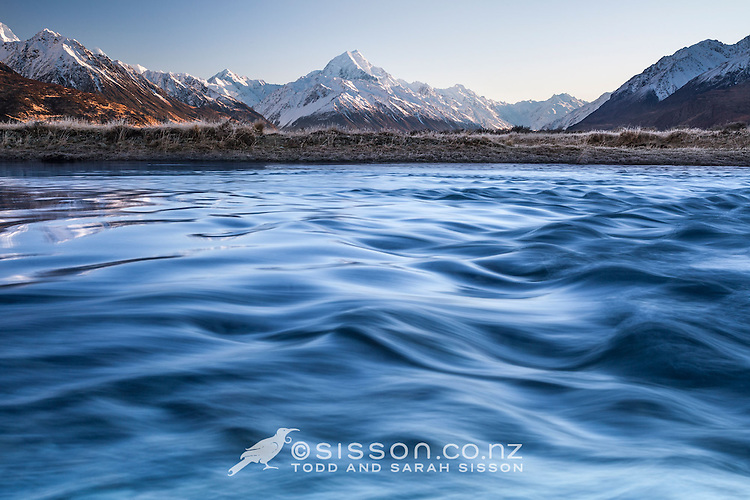 Winter sunrise looking across the Tasman River towards Aoraki / Mt Cook covered in snow, Mackenzie Country, Canterbury, New Zealand - stock photo, canvas, fine art print