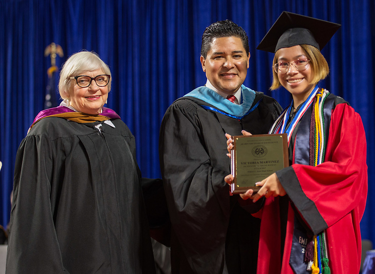 Houston ISD Superintendent Richard Carranza presents Victoria Martinez with a Board Award during the Furr / Reach High School graduation in Delmar Fieldhouse, May 26, 2017. The ceremony was the first graduation to be held in the newly constructed facility.