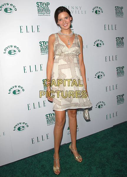 MAGGIE GRACE .Attends The Elle is Going Green Party and Concert held at Boulevard3 in Hollywood, California, USA..April 5th, 2007 .full length white cream beige pattern t bar silver shoes dress sleeveless necklace purse bag .CAP/DVS.©Debbie VanStory/Capital Pictures
