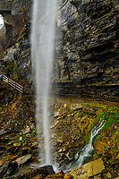 Waterfall cascading over the Indian Ladder Train in John Boyd Thatcher Park in New York State