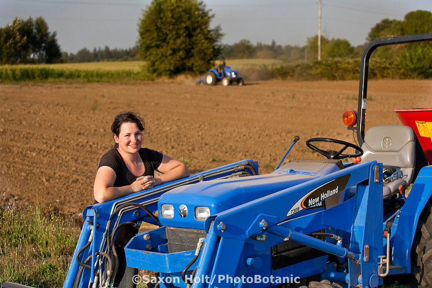 Woman farmer and tractor, in a fresh tilled field, Viridian Farms, Oregon