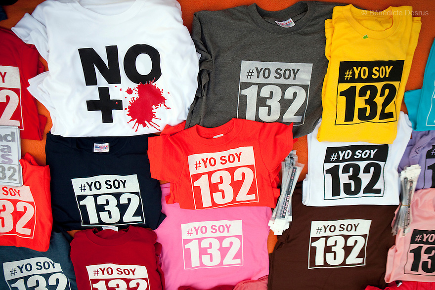 "30 June 2012 - Mexico City, Mexico - Vendors sells tshirt with message ""Yo Soy 132"" or ""No more blood"". Thousands of demonstrators and university students members of the movement ?yo soy 132? (I am 132) hold candles during a demonstration to demand transparency in the next election at Zocalo square in Mexico City. ""YoSoy132"" movement was organized by students against the candidature of Enrique Pena Nieto, presidential candidate of the opposition Institutional Revolutionary Party (PRI), who also demanded a balance in the media coverage of the presidential race. Mexico's presidential elections will take place on July 1. Photo credit: Benedicte Desrus"