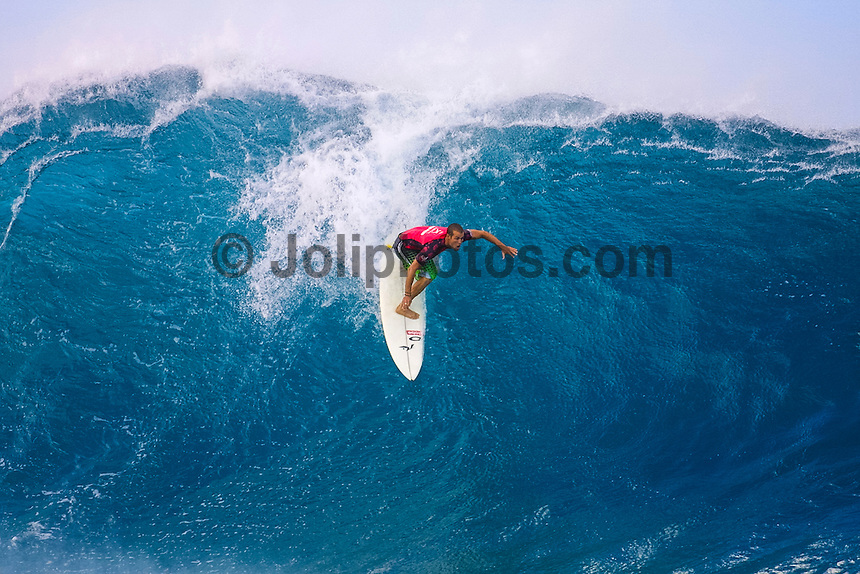 North Shore, Oahu,Hawaii.  CJ Hobgood (USA)  surfing here in the Pipeline Masters contest was crowned the 2001 ASP World Professional Surfing Champion in a year that was cut short by the tourist attacks of 9/11. Photo:joliphotos.com
