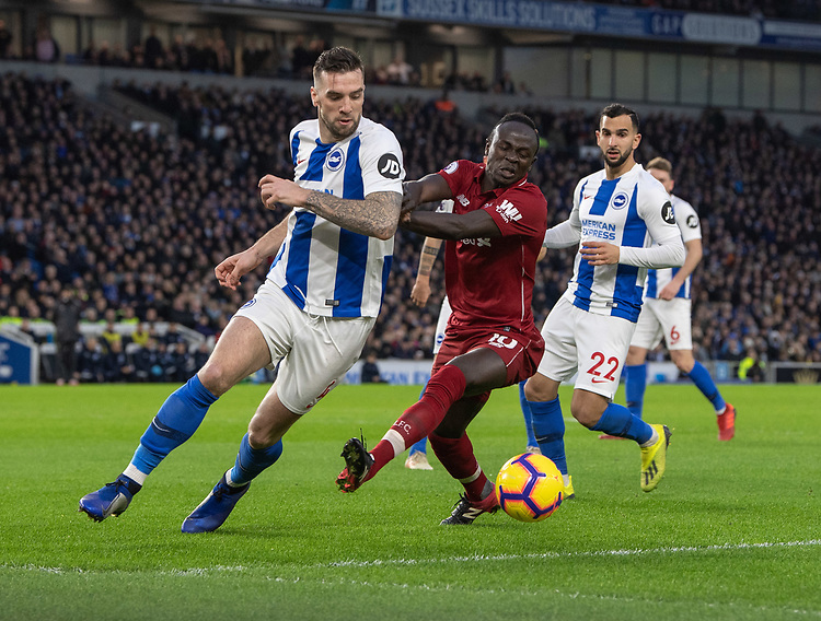Liverpool's Sadio Mane (right) battles with Brighton & Hove Albion's Shane Duffy (left) <br /> <br /> Photographer David Horton/CameraSport<br /> <br /> The Premier League - Brighton and Hove Albion v Liverpool - Saturday 12th January 2019 - The Amex Stadium - Brighton<br /> <br /> World Copyright © 2018 CameraSport. All rights reserved. 43 Linden Ave. Countesthorpe. Leicester. England. LE8 5PG - Tel: +44 (0) 116 277 4147 - admin@camerasport.com - www.camerasport.com