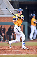 University of North Carolina Greensboro (UNCG) Spartans catcher Ryan Clinch (7) swings at a pitch during a game against the Tennessee Volunteers at Lindsey Nelson Stadium on February 24, 2018 in Knoxville, Tennessee. The Volunteers defeated Spartans 11-4. (Tony Farlow/Four Seam Images)