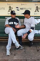 OAKLAND, CA - AUGUST 18:  Reggie Jackson #44 and Alex Rodriguez #13 of the New York Yankees sit in the dugout before the game against the Oakland Athletics at the Oakland-Alameda County Coliseum on August 18, 2009 in Oakland, California. Photo by Brad Mangin
