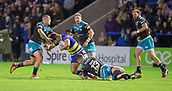 2nd February 2019, Halliwell Jones Stadium, Warrington, England; Betfred Super League rugby, Warrington Wolves versus Leeds Rhinos; Stefan Ratchford is tackled by Kallum Watkins and Stevie Ward