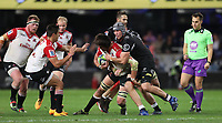 Franco Mostert of the Emirates Lions tackled by Jean-Luc du Preez and Stephan Lewies of the Cell C Sharks during the Vodacom Super Rugby match between the Cell C Sharks and the Emirates Lions the at Growthpoint Kings Park in Durban, South Africa. 15th July 2017(Photo by Steve Haag)