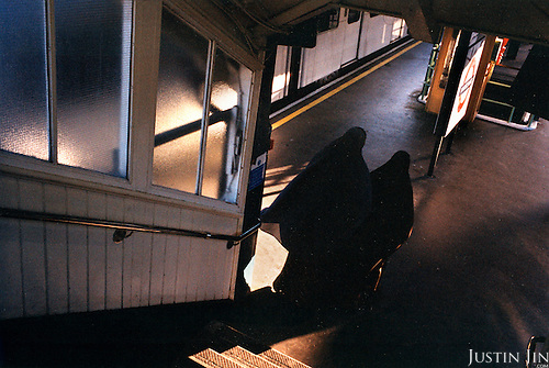Muslim women enter the platform of London's East Ham metro station platform...Picture taken 2005 by Justin Jin