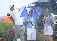151206 Adam Scott in the downpour on the 1st tee during Sunday's Final Round of the Hero World Challenge at The Albany Golf Club, in New Providence, Nassau, Bahamas.(photo credit : kenneth e. dennis/kendennisphoto.com)