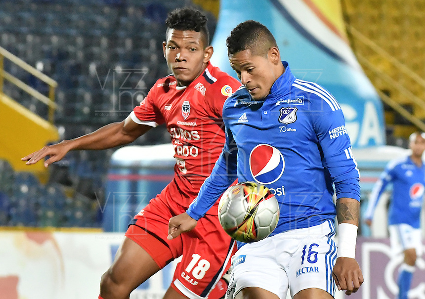 BOGOTA - COLOMBIA -13 -08-2016: Ayron del Valle (Der) jugador de Millonarios disputa el balón con Almir Soto (Izq) jugador de Fortaleza CEIF durante partido por la fecha 8 de la Liga Aguila II 2016 jugado en el estadio Nemesio Camacho El Campin de la ciudad de Bogota./ Ayron del Valle (R) player of Millonarios fights for the ball with Almir Soto (L) player of Fortaleza CEIF during match for the date 8 of the Liga Aguila II 2016 played at the Nemesio Camacho El Campin Stadium in Bogota city. Photo: VizzorImage / Gabriel Aponte / Staff.