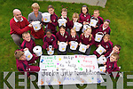 PHONE IT IN: As part of a charity campaign, pupils from Moyderwell Primary School are seeking old mobile phones to help sick children..From front l-r were: Kevan Foley, Patrick Kearney, Simi ?, Sandra Sabliuskaite, Patricia Griciute, Klaudija Griciute, Vilte Dubukaite, David O'Connor Fitzgibbon and Sean Stack Pullen..Back l-r were: Mr. Denis Griffin, Mrs. Margaret Moriarty, Rachel Maloney, Micahel Kerins, Maeve O'Donoghue, Tomas Majdacki and Kellie O'Connor..