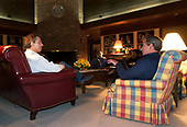 United States President George W. Bush and British Prime Minister Tony Blair meet, Wednesday night, March 26, 2003 at Camp David, the presidential retreat near Thurmont, Maryland. Also pictured in background are Chief of Staff Andy Card and National Security Advisor Condoleezza Rice. <br /> Mandatory Credit: Eric Draper / White House via CNP