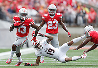Ohio State Buckeyes cornerback Eli Apple (13) runs the ball after an interception in the first quarter of the college football game between the Ohio State Buckeyes and the Northern Illinois Huskies at Ohio Stadium in Columbus, Saturday afternoon, September 19, 2015. As of half time the Ohio State Buckeyes were tied with the Northern Illinois Huskies 10 - 10. (The Columbus Dispatch / Eamon Queeney)