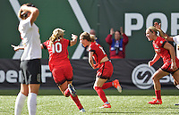 Portland, Oregon - Sunday October 2, 2016: Portland Thorns FC defender Emily Sonnett (16) celebrates after scoring a goal during a semi final match of the National Women's Soccer League (NWSL) at Providence Park.