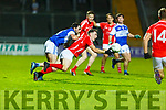East Kerrys Paudie Clifford releases the ball as he is under pressure from Cormac Coffey of Kerins O'Rahillys v East Kerry  in the County Football Championship 3rd round game on Saturday.