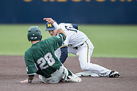 Michigan Wolverines second baseman Jimmy Kerr (15) attempts to tag Michigan State Spartans baserunner Matt Byars (28) on May 19, 2017 at Ray Fisher Stadium in Ann Arbor, Michigan. Michigan defeated Michigan State 11-6. (Andrew Woolley/Four Seam Images)