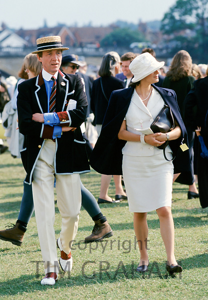 Spectators wearing traditional blazer and boater hat at Henley Royal Yachting Regatta, Henley-on-Thames,UK