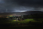 A small village nestled in trees on the Yorkshire moors