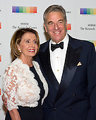 United States House Minority Leader Nancy Pelosi (Democrat of California) and her husband, Paul, arrive for the formal Artist's Dinner honoring the recipients of the 38th Annual Kennedy Center Honors hosted by United States Secretary of State John F. Kerry at the U.S. Department of State in Washington, D.C. on Saturday, December 5, 2015. The 2015 honorees are: singer-songwriter Carole King, filmmaker George Lucas, actress and singer Rita Moreno, conductor Seiji Ozawa, and actress and Broadway star Cicely Tyson.<br /> Credit: Ron Sachs / Pool via CNP