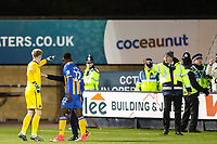 Goalkeeper Dean Henderson of Shrewsbury Town runs towards the Bradford City fans and is led away by Shrewsbury Town manager Paul Hurst during the Sky Bet League 1 match between Shrewsbury Town and Bradford City at Greenhous Meadow, Shrewsbury, England on 25 November 2017. Photo by Thomas Gadd.