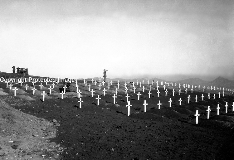 Marines of the First Marine Division pay their respects to fallen buddies during memorial services at the division's cemetery at Hamhung, Korea, following the break-out from Chosin Reservoir, December 13, 1950.  Cpl. Uthe. (Marine Corps)<br /> NARA FILE #:  127-N-A5426<br /> WAR &amp; CONFLICT BOOK #:  1514