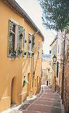FRANCE, Menton in Cote d'Azur, two rows of yellow houses with blue shutters