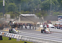 Jun 4, 2016; Epping , NH, USA; NHRA top fuel driver Steve Torrence (right) races alongside Brittany Force during qualifying for the New England Nationals at New England Dragway. Mandatory Credit: Mark J. Rebilas-USA TODAY Sports