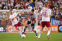 Juan Pablo Angel (9) of CD Chivas USA fouls Dax McCarty (11) of the New York Red Bulls. The New York Red Bulls and CD Chivas USA played toa 1-1 tie during a Major League Soccer (MLS) match at Red Bull Arena in Harrison, NJ, on May 23, 2012.