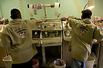 ALGODONES, MEXICO-MARCH 24: Workers polish glass in a workshop for Algdones Optical March 24,2005 in Algodones. Optical shops in town advertise 1-2 hour service for most customers due to the fact that most work is done  locally. ©Radhika Chalasani
