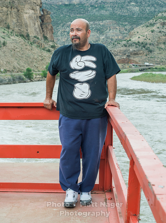 Dam Tender Al Gallegos at the Grand Valley Diversion Dam along the Colorado River near Grand Junction, Colorado, Sunday, July 5, 2015. The dam is a 14-foot (4.3 m) high, 546-foot (166 m) long concrete roller dam with six gates, which were the first and largest of their kind to be installed in the United States. The dam is primarily used for irrigation for the Grand Valley.<br /> <br /> Photo by Matt Nager
