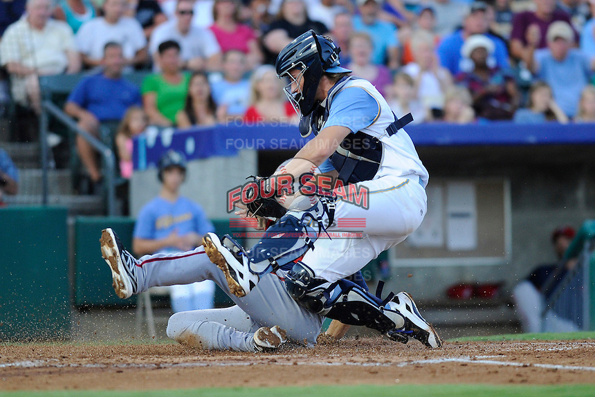 Catcher Kellin Deglan (6) of the Myrtle Beach Pelicans holds his ground as he tags out Cole Leonida trying of the Potomac Nationals trying to score on Friday, August 9, 2013, at TicketReturn.com Field in Myrtle Beach, South Carolina. Myrtle Beach won, 3-2. (Tom Priddy/Four Seam Images)