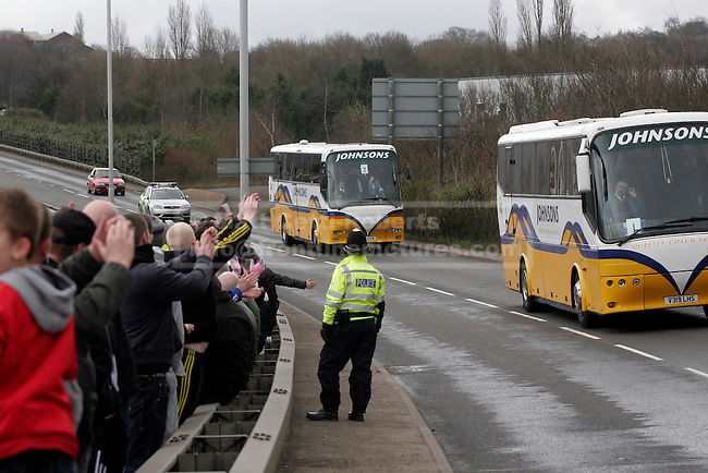 Coaches carrying EDL members to the holding area on a duel carriageway outside Dudley are welcomed by waiting demonstrators.