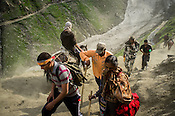 Hindu pilgrims walk along the glaciers enroute to the revered Hindu pilgrimage, the Amarnath yatra in Kashmir, India. Hindu pilgrims brave sub zero temperature and high latitude passes and make their pilgrimage to reach the sacred Amarnath cave, which houses a lingam - a stylized phallus, worshiped by Hindus as a symbol of God Shiva. Photo: Sanjit Das/Panos