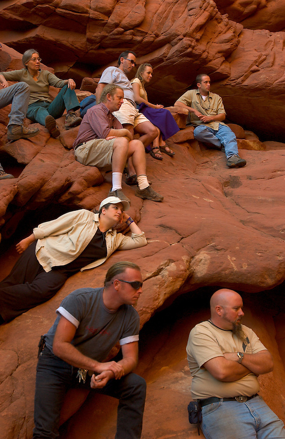 Festival staff members and volunteers listen to J.S. Bach's Brandenburg Concerto No. 3 in G Major on a wramup before a concert at a natural red rock grotto in a Colorado River canyon wall, for the Moab Music Festival in Moab, Utah, Thursday, Sept. 16, 2004. The group includes vilonists Axel Strauss, left, Laura Frautschi and L.P. How, violists Jennifer Frautschi, Leslie Tomkins and Paul Hersh, pianist Michael Barrett, cellists Mark Summer, Noriko Kishi and Tanya Tomkins, and bassist Robert Black. (Kevin Moloney for the New York Times)
