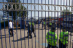 Birmingham City 1 Wolverhampton Wanderers 1, 01/05/2011. St Andrews, Premier League. Visiting fans making their way past police officers on Cattall Road before entering St. Andrew's stadium, prior to Birmingham City's Barclay's Premier League match with Wolverhampton Wanderers. Both clubs were battling against relegation from  England's top division. The match ended in a 1-1 draw, watched by a crowd of 26,027. Photo by Colin McPherson.